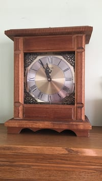 Brown wooden framed pendulum clock Calgary, T3G 2V7
