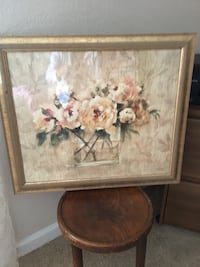 Brown wooden framed painting of white flowers