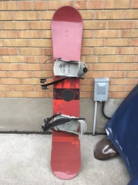 red and black snowboard with bindings 544 km