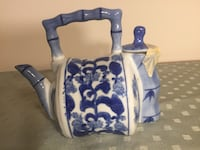 white and blue floral ceramic teapot 32 km