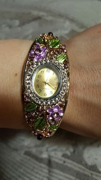 purple and green gemstone embellished analog watch