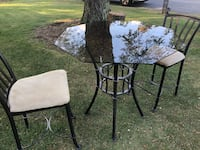 Glass table with matching metal chairs Bethlehem