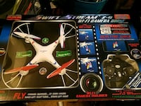 white and black quadcopter drone with box Capitol Heights, 20743