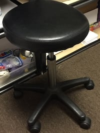 round black padded office rolling chair