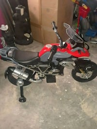 toddler's red, gray, and black motorcycle with training wheels plastic toy Buffalo, 14210