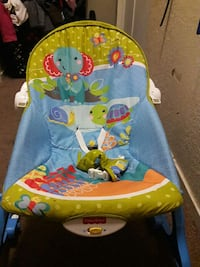 baby's blue and green Fisher Price bouncer Merced, 95340