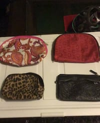 Three make up bags and one black wallet
