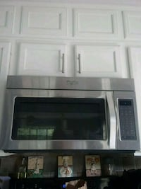 black and gray microwave oven 136 mi