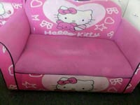 pink and white Minnie Mouse print sofa