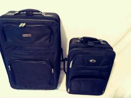 2 like new suitcases