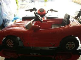 children's red ride on toy car