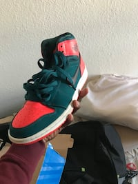 unpaired green and red Air Jordan 1 shoe