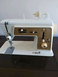 Heavy duty singer sewing machine good working condition $50.00. (Model