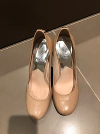 pair of brown Michael Kors leather platform pumps