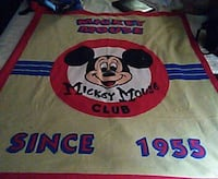 red, beige, blue, and white Mickey Mouse Since 1955 comforter