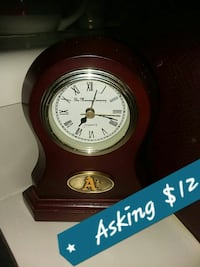 brown and white analog mantle clock
