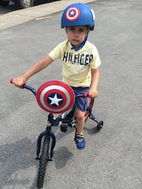 toddler's white and blue trike captain America Laval, H7R 4P7