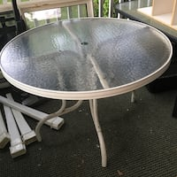 round white metal framed glass top patio table Harrisburg, 17103