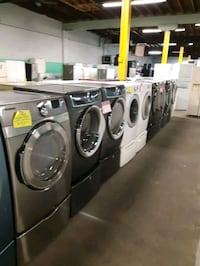 FRONT LOAD WASHER AND DRYER SET WITH PEDESTAL WORKING PERFECTLY  Baltimore, 21201