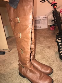pair of brown leather 4-buckle riding boots