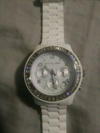 round silver-colored chronograph watch with link b Chattanooga, 37415