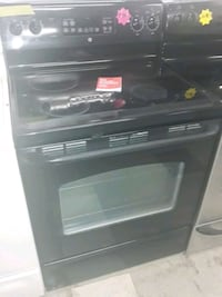 Ge glass top stove black in good condition