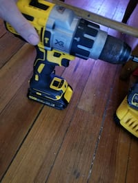 Dewalt hammer drill with battery and a 60v max battery