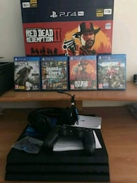 black Sony PS3 slim console with controller and game cases Stoke Newington, N16