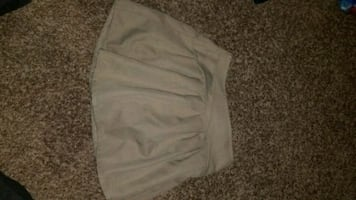Girls tan polo uniform skirt size 5
