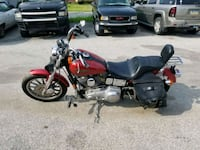 red and black touring motorcycle Dallastown, 17313