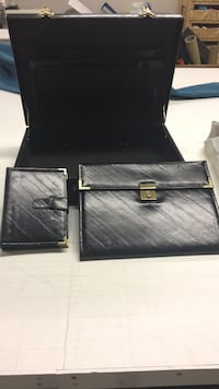Black leather brief case with time planner and a paper holding thing Langley, V4W 3V9