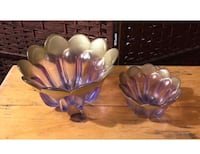 two scalloped-edge round purple translucent glass bowls