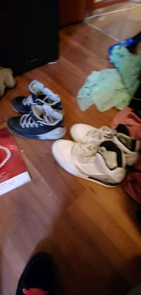 2 pairs of Jordan shoes white pair 50 black pair 30