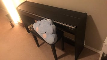 Roland F140R digital piano and leather seat