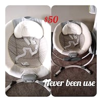 baby's gray and white cradle and swing Edmonton, T6B 0E2