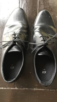 pair of black H and M size 10leather dress shoes Manassas, 20110