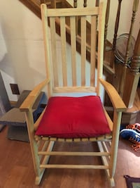 brown wooden framed red padded armchair 68 mi
