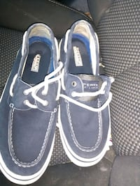 pair of black-and-white Sperry boat shoes Greensboro, 27455