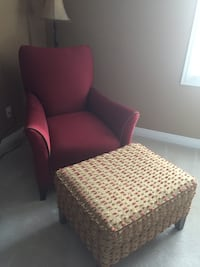 red fabric armchair with ottoman
