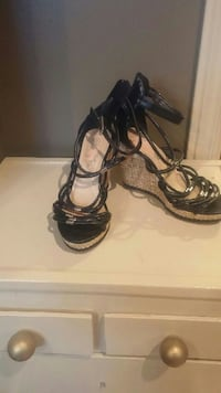 pair of black leather gladiator wedge sandals Memramcook, E4K