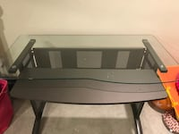 Black and gray metal desk. The shelf under the glass pulls out for a keyboard. Silver Spring, 20906