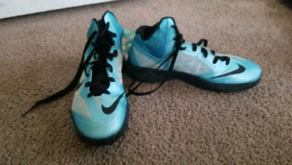 pair of blue-and-black Nike basketball shoes