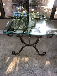 Glass and wrought iron table beautiful piece very solid no scratches