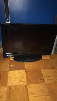 black flat screen TV with remote New York, 11434
