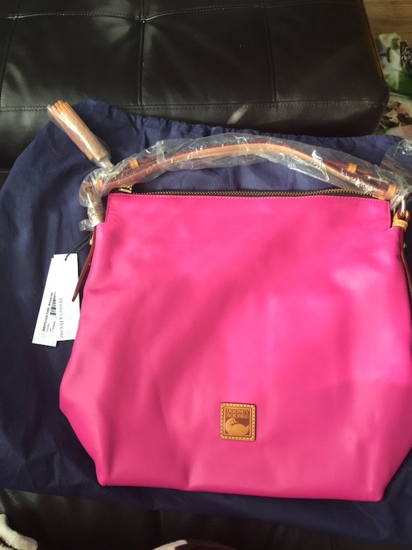 836dcc6325 Used Dooney   Bourke McKenzie Hobo and matching wallet pouch. for sale in  Hamilton