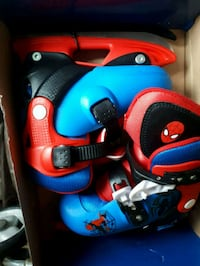 red-and-blue inline skates Winnipeg, R2L 0A7