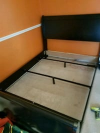 brown and black wooden bed frame
