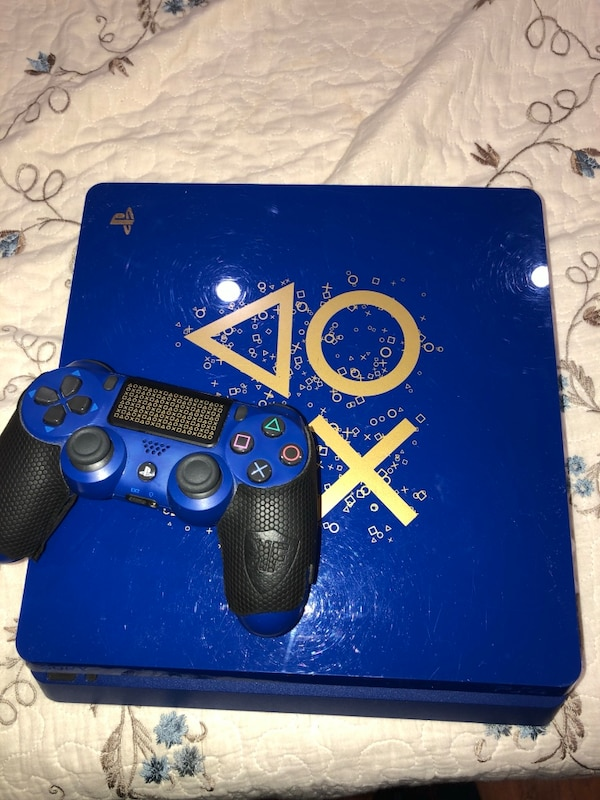 blue Sony PS4 console with controller