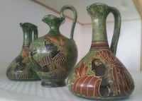 three brown-and-green ceramic vases with hadle