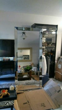 Designer style mirror this mirror which is 30 in by 70 in